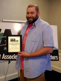 Ben Chiappinelli of Mt Mansfield Media accepts TV Best in Show award