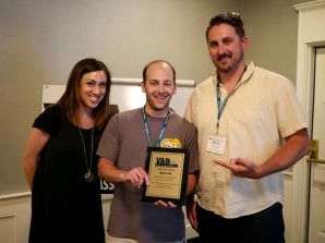 Kate Lanza Devon McGarry and Mitch Terricciano of WIZN accept Radio Best in Show Award